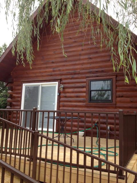Ridgedale Log Cabin Restoration rustic-exterior