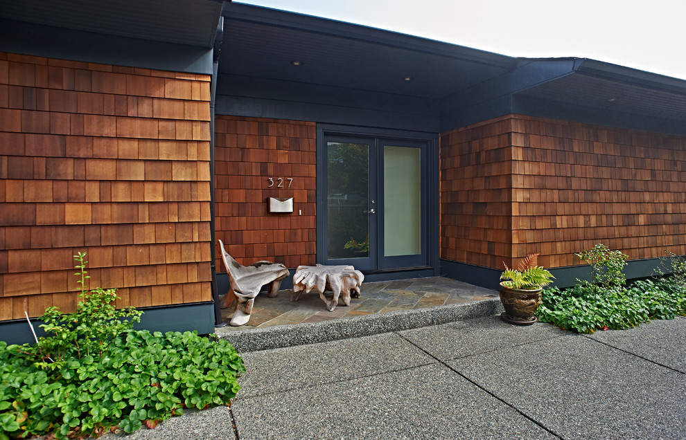 Example of a small classic gray one-story wood house exterior design in Vancouver with a hip roof and a shingle roof