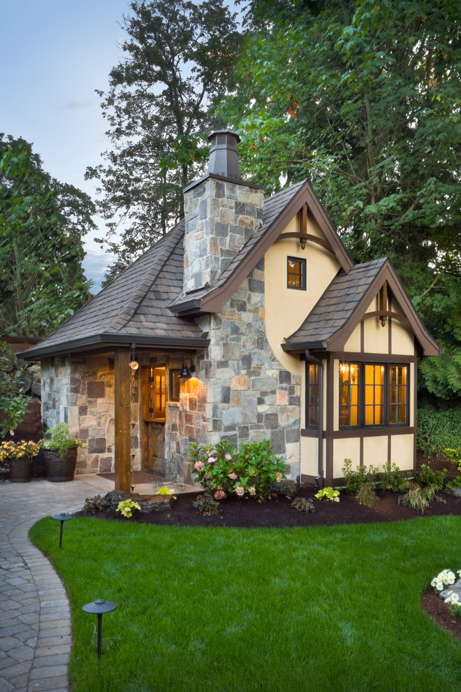 Elegant beige two-story exterior home photo in Portland