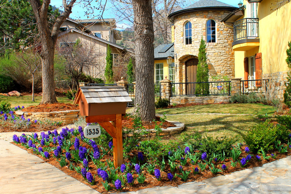 Example of a tuscan stone exterior home design in Denver