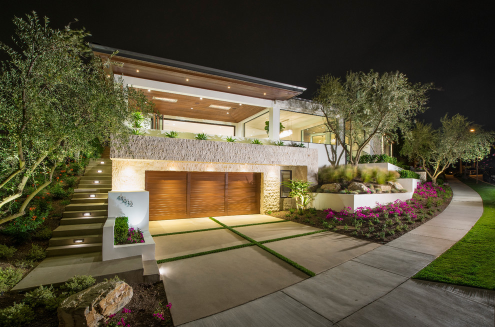 Large and white contemporary two floor render exterior in Orange County with a flat roof.