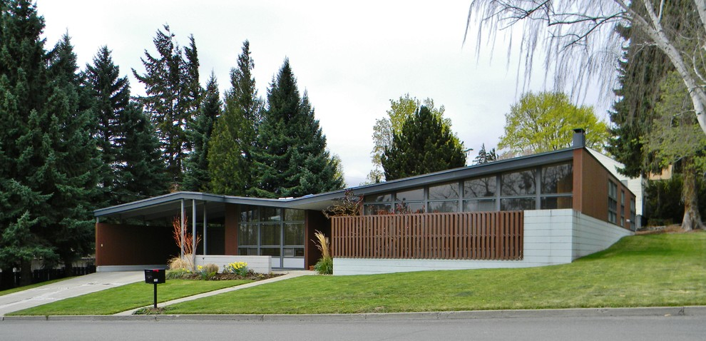 Mid-century modern concrete exterior home photo in Seattle