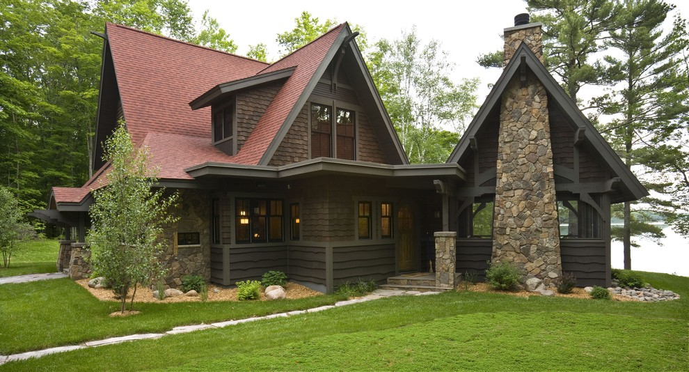 Mountain style brown two-story wood gable roof photo in Minneapolis with a red roof