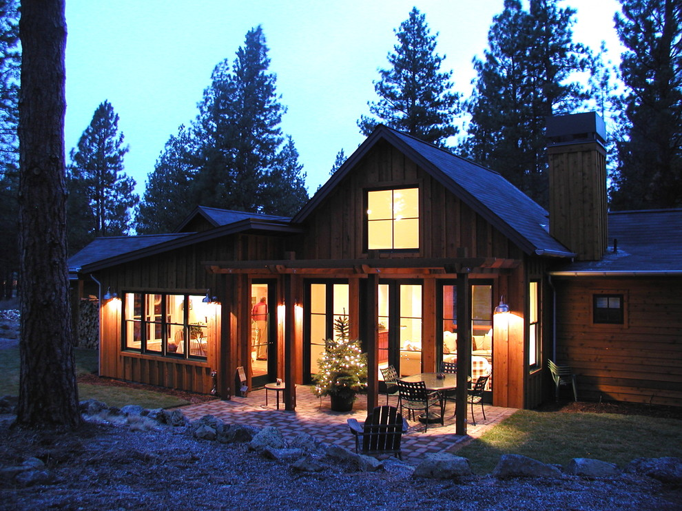Mid-sized mountain style two-story wood gable roof photo in Denver