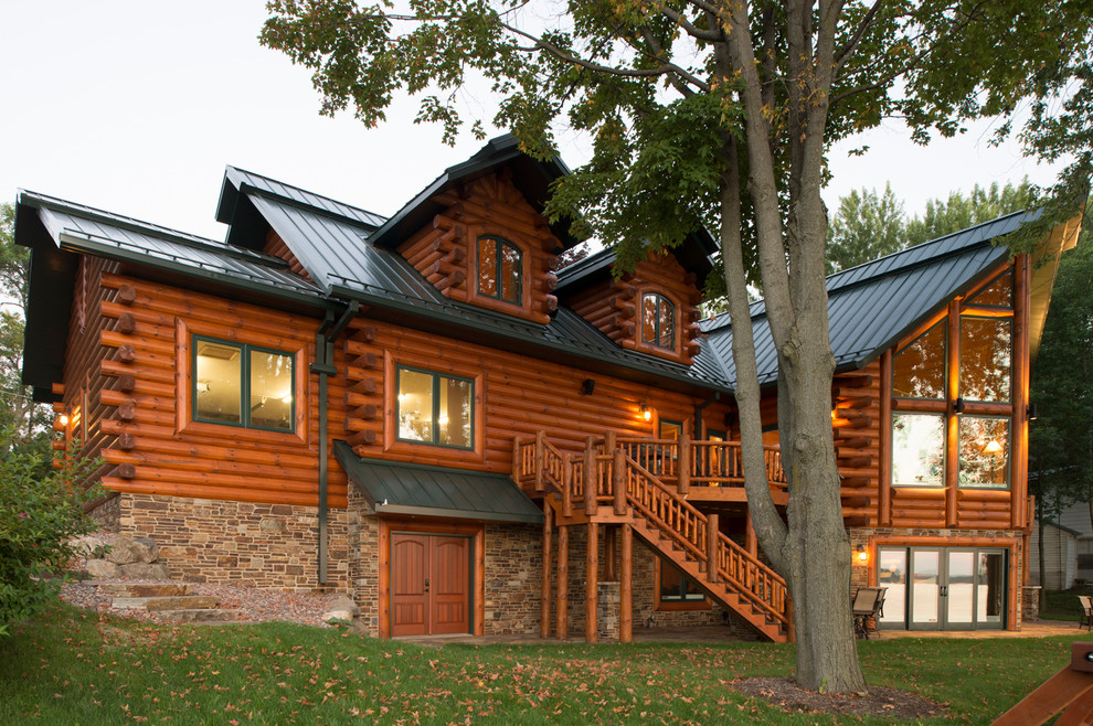 Inspiration for a rustic two-story wood exterior home remodel in Other