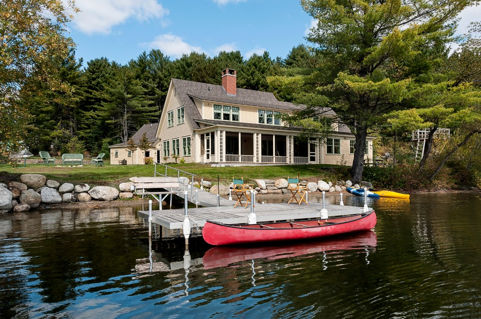 Inspiration for a rustic two-story exterior home remodel in Burlington