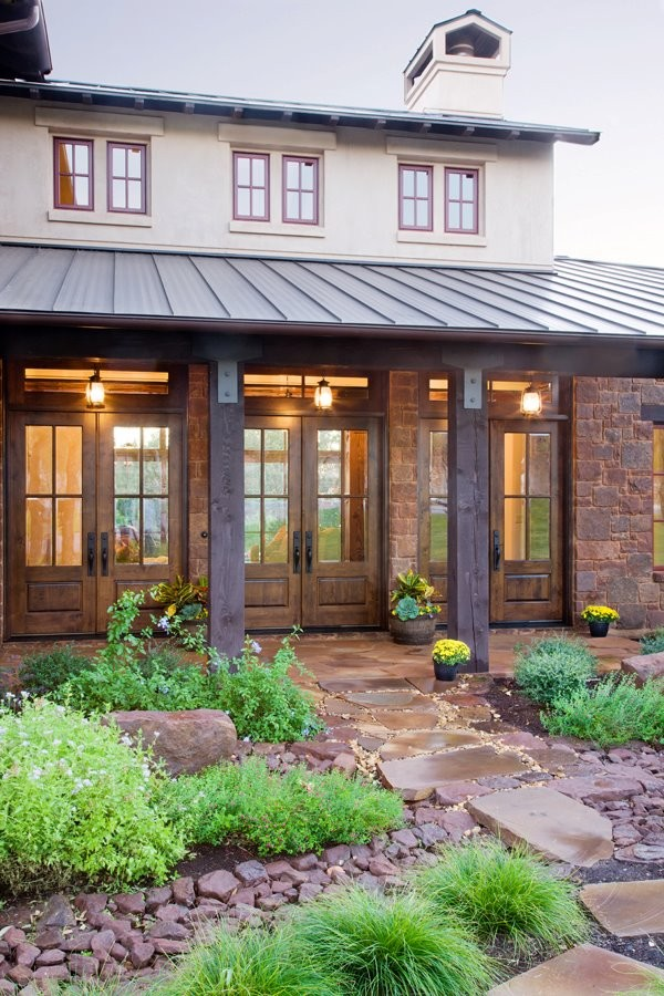 Example of an eclectic exterior home design in Austin