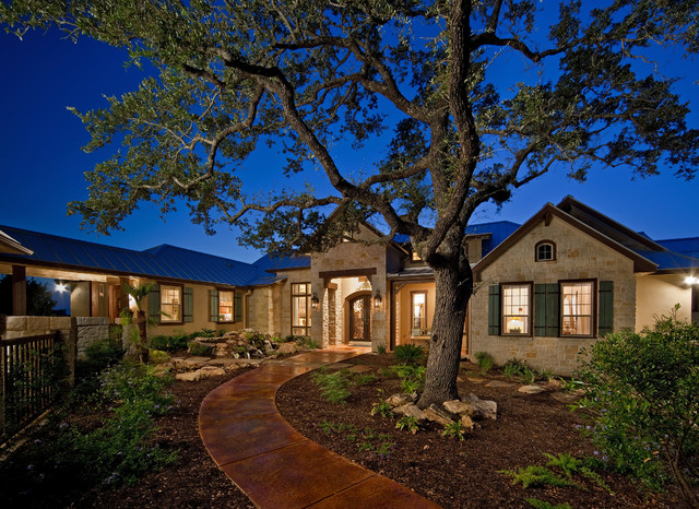 Rustic home rustic exterior by authentic custom homes for Custom rustic homes