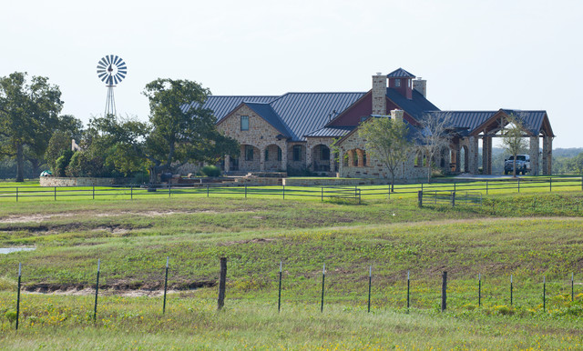 Rustic timber frame home on tx ranch traditional for Rustic texas home plans