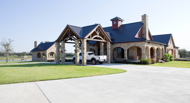 Rustic timber frame home on tx ranch traditional for Ranch style timber frame homes