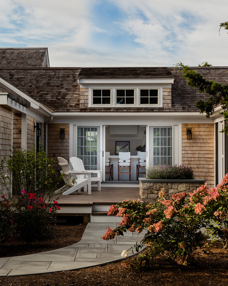 Example of a transitional two-story wood exterior home design in Boston with a shingle roof
