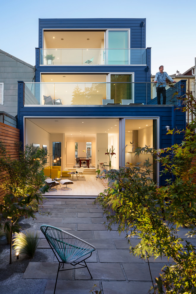 Mid-sized contemporary blue three-story wood exterior home idea in San Francisco with a mixed material roof