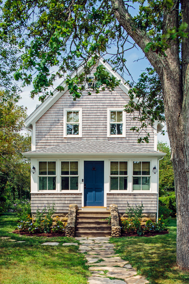 Coastal beige two-story wood exterior home idea in Boston with a shingle roof
