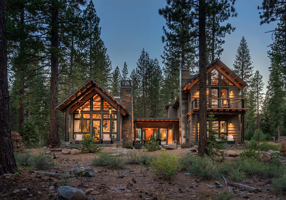 Example of a large mountain style brown two-story wood gable roof design in Sacramento