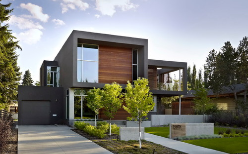 Dark grey wall finish is it steel troweled stucco looks for Modern home exterior finishes