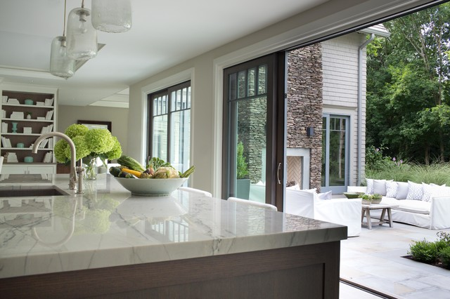 Seamless kitchen to patio transition for Transition windows for homes