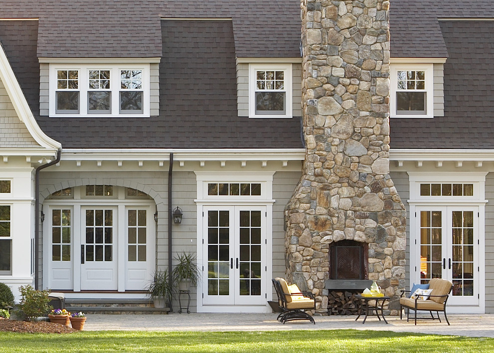 Large traditional gray two-story wood house exterior idea in Boston with a shingle roof