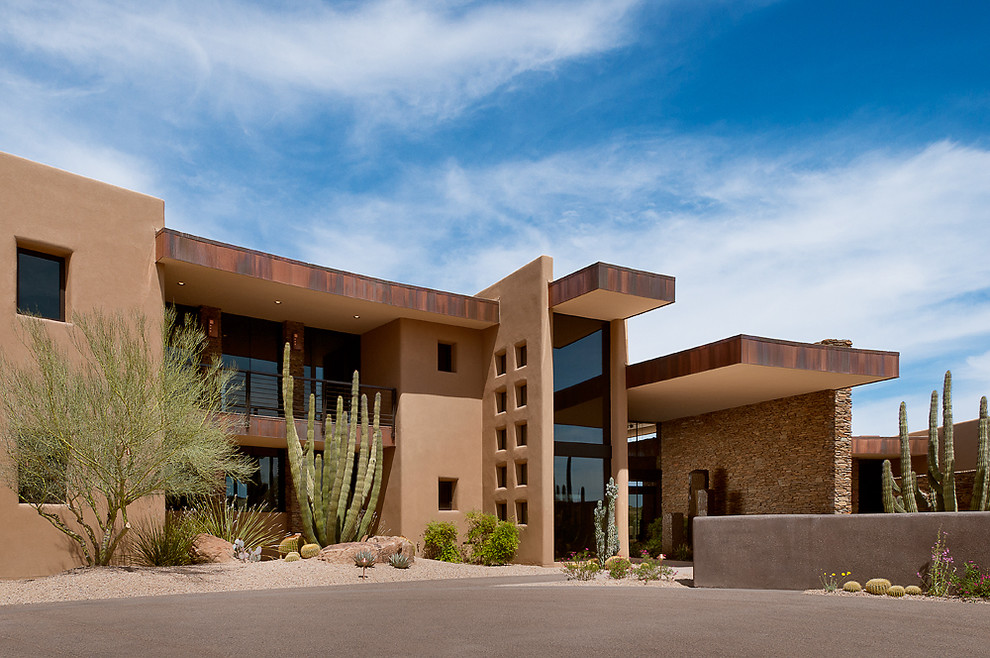 Example of a southwest two-story exterior home design in Phoenix