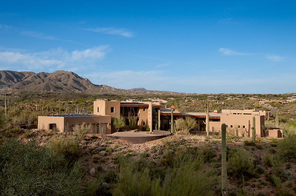 Inspiration for a huge southwestern two-story exterior home remodel in Phoenix