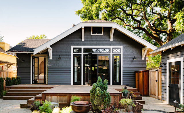 Arts and crafts gray one-story exterior home photo in Portland with a clipped gable roof
