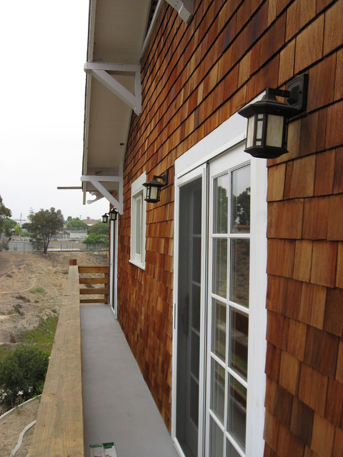 Semi Transparent Stain On Cedar Shingle House