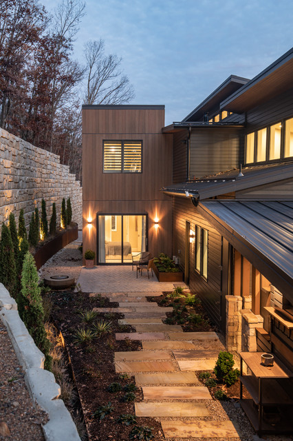 Inspiration for a large modern multicolored split-level mixed siding house exterior remodel in Other