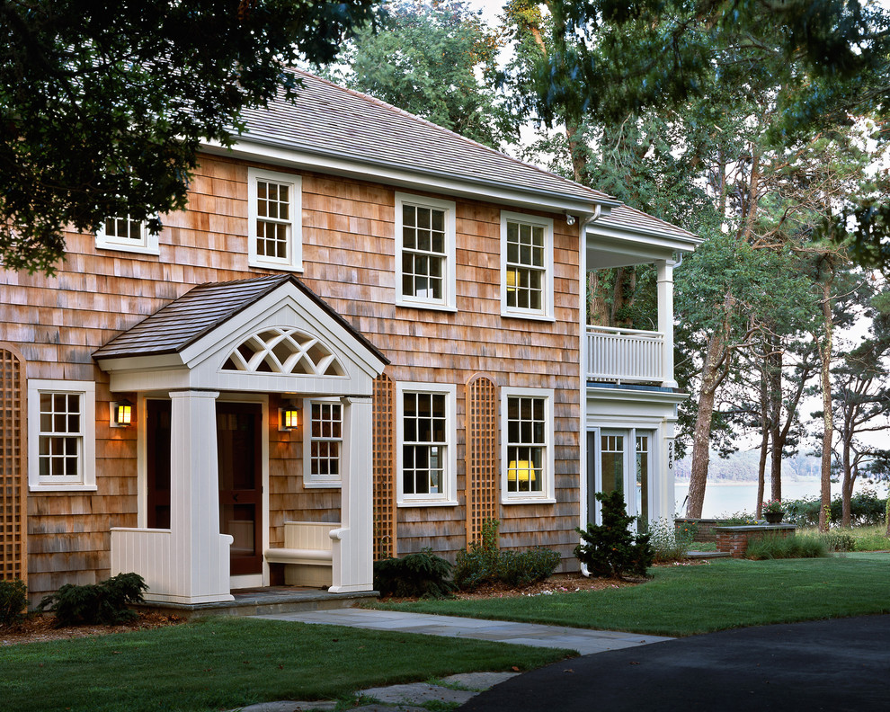 Inspiration for a timeless two-story wood exterior home remodel in Boston