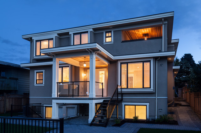 Large and blue classic exterior in Vancouver with three or more floors and concrete fibreboard cladding.