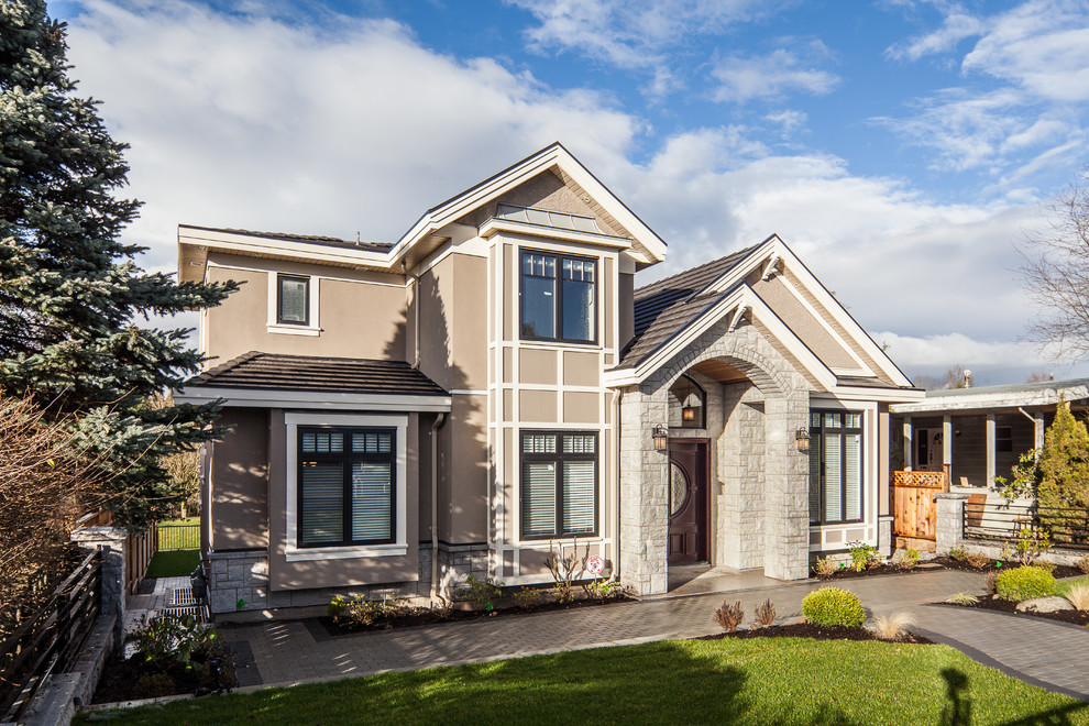Transitional exterior home idea in Vancouver