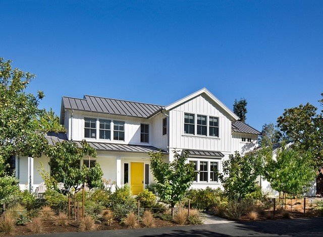 Shades of white farmhouse exterior other metro by for Classic home designs inc
