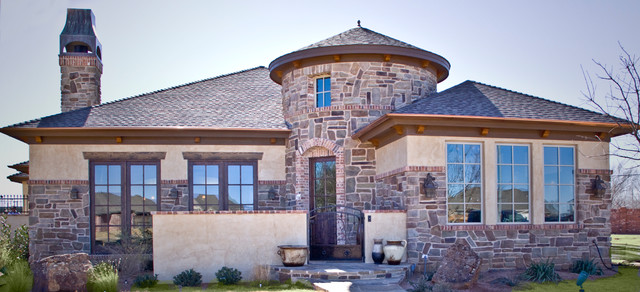 Mountain style one-story stone exterior home photo in Austin