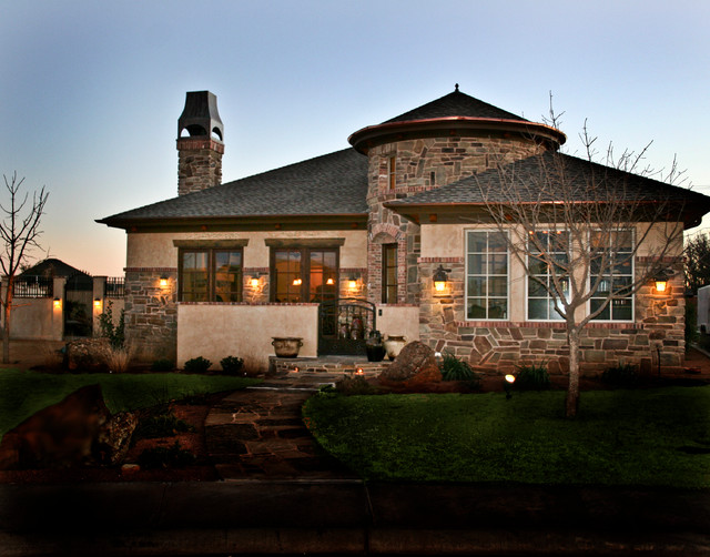 Example of a tuscan one-story stone exterior home design in Austin