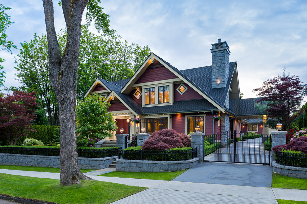 Large craftsman red two-story wood gable roof idea in Vancouver