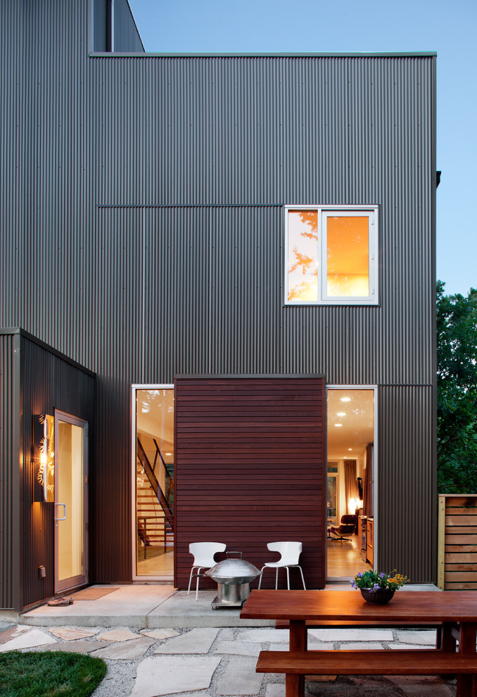 Inspiration for a modern wood exterior home remodel in Kansas City