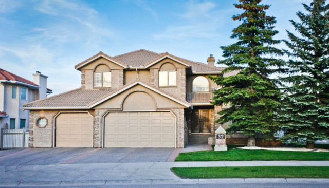 Transitional exterior home photo in Calgary