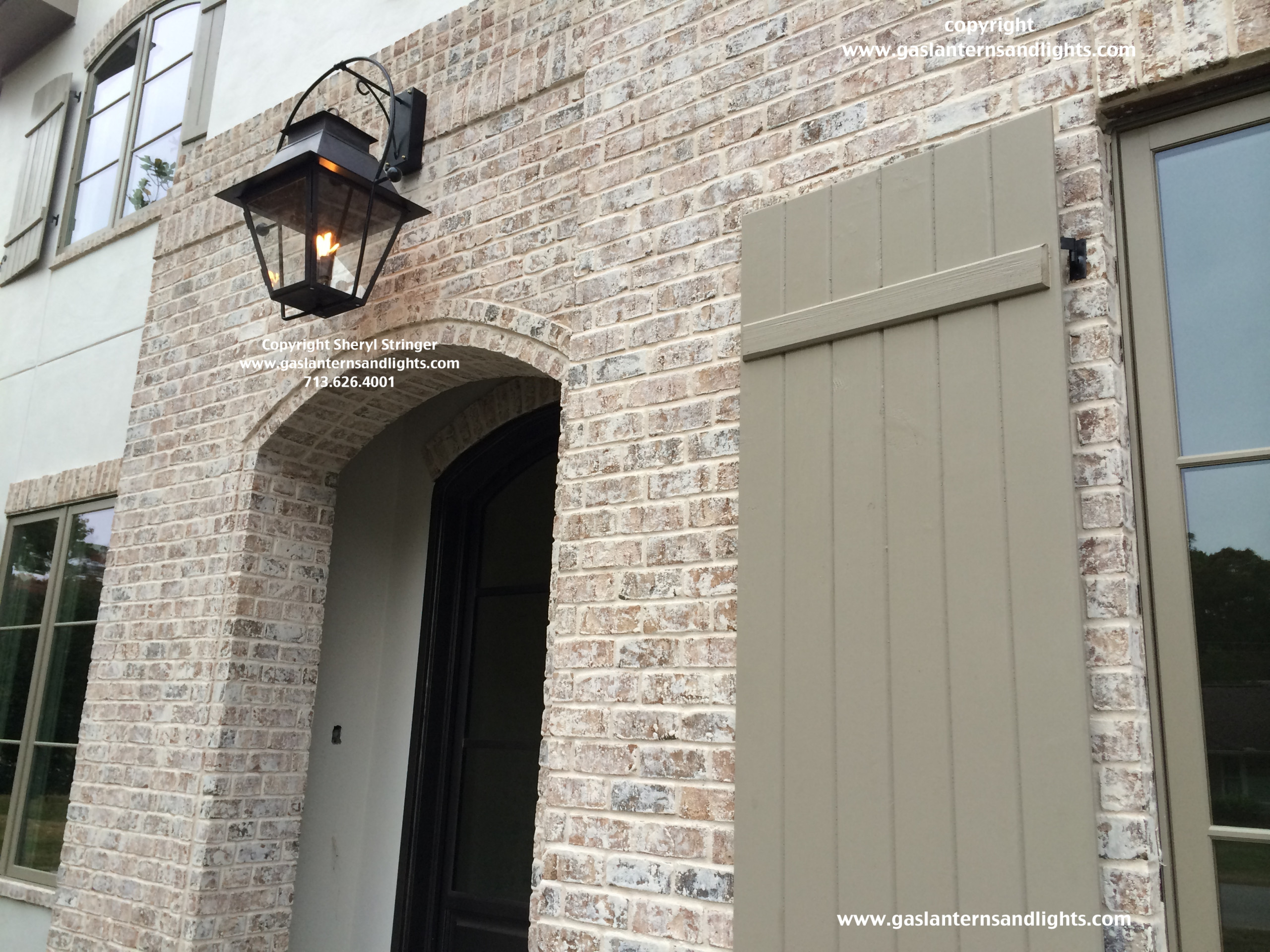 Sheryl's Extra Large V Style Gas Lantern Hanging Over Front Door