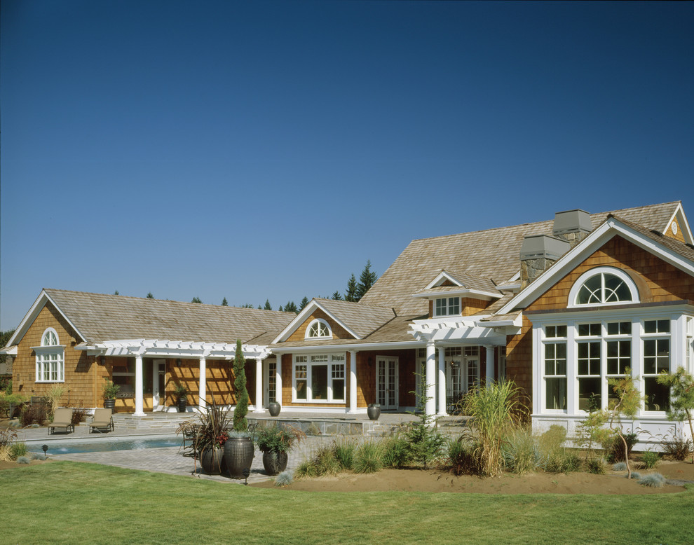 Mid-sized traditional one-story wood exterior home idea in Portland