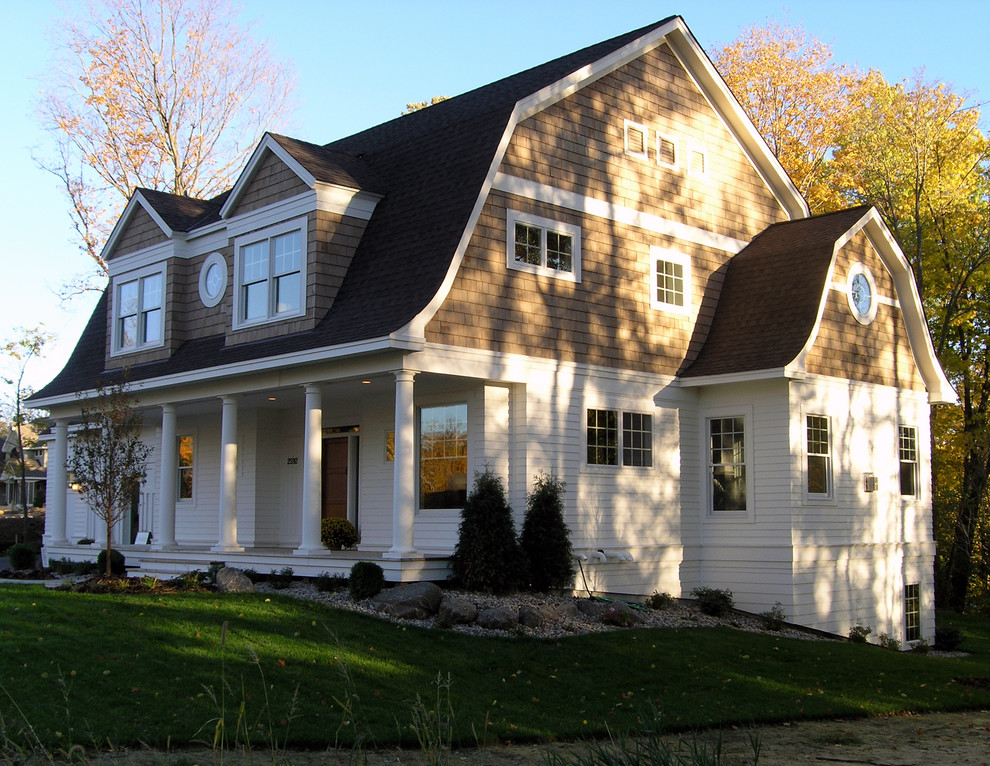 Inspiration for a mid-sized victorian two-story wood exterior home remodel in Minneapolis with a gambrel roof