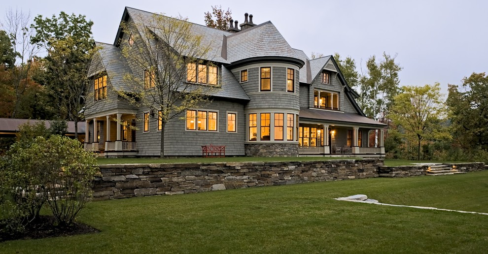 Large ornate two-story wood exterior home photo in Burlington