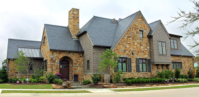 Example of a large classic two-story stone duplex exterior design in Dallas
