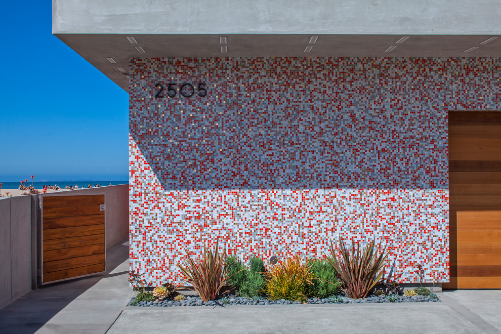 Example of a trendy concrete exterior home design in Los Angeles