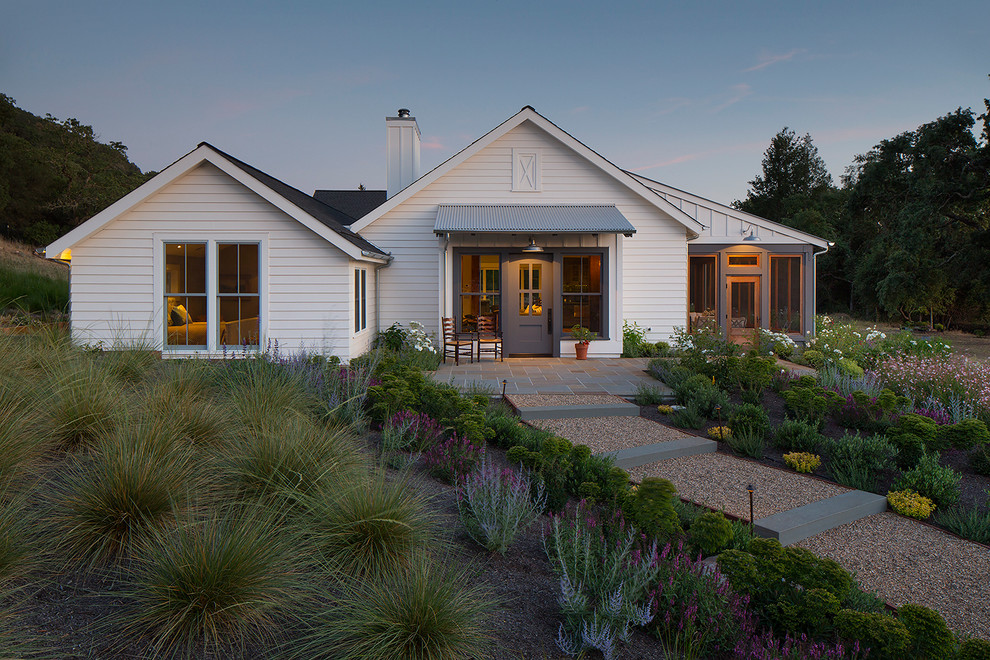 Cottage white one-story gable roof photo in San Francisco