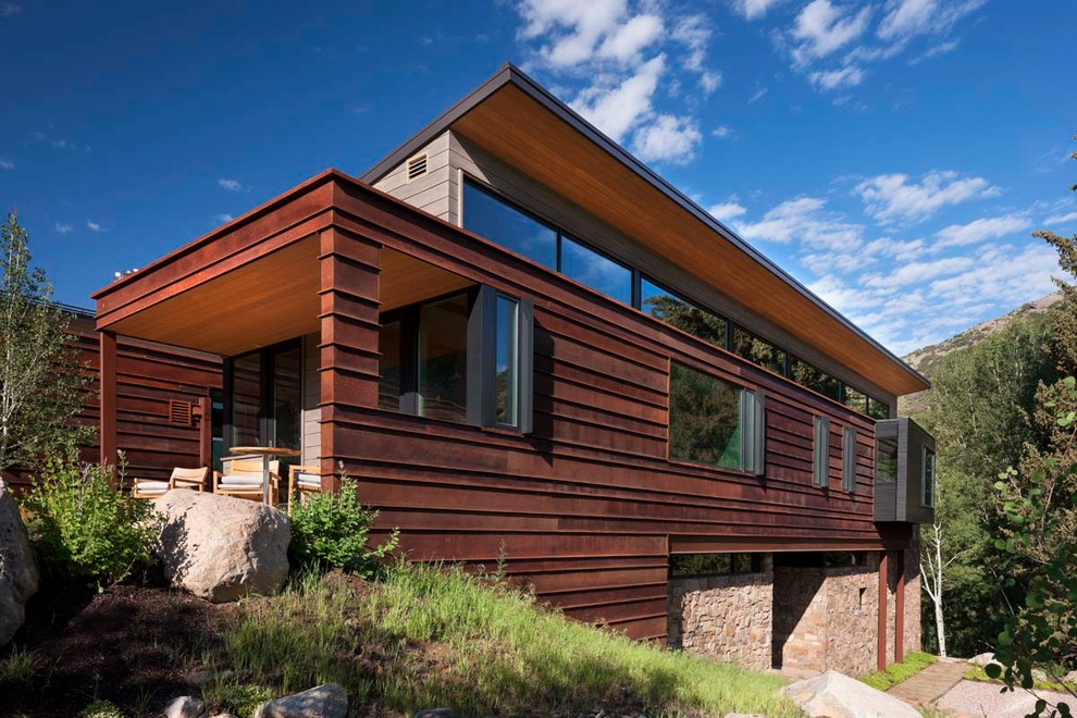 Inspiration for a large contemporary beige two-story mixed siding exterior home remodel in Denver