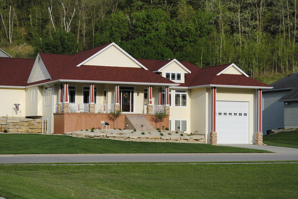 Example of a mid-sized classic one-story vinyl exterior home design in Other
