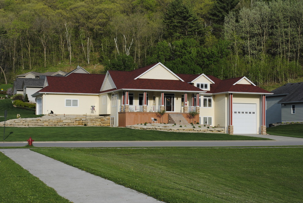 Mid-sized elegant one-story vinyl exterior home photo in Other