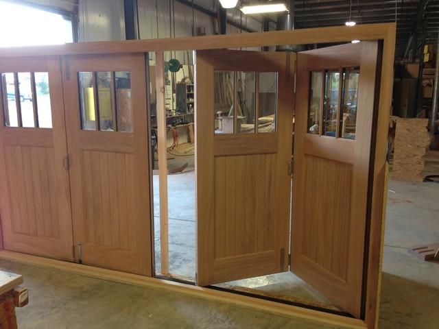 Slide and Fold Mahogany Doors - dc metro - by Clingerman Doors - Custom Wood Garage Doors