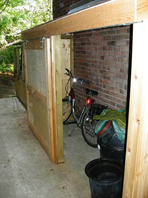 Small storage shed with sliding door contemporary for Side of the house storage shed