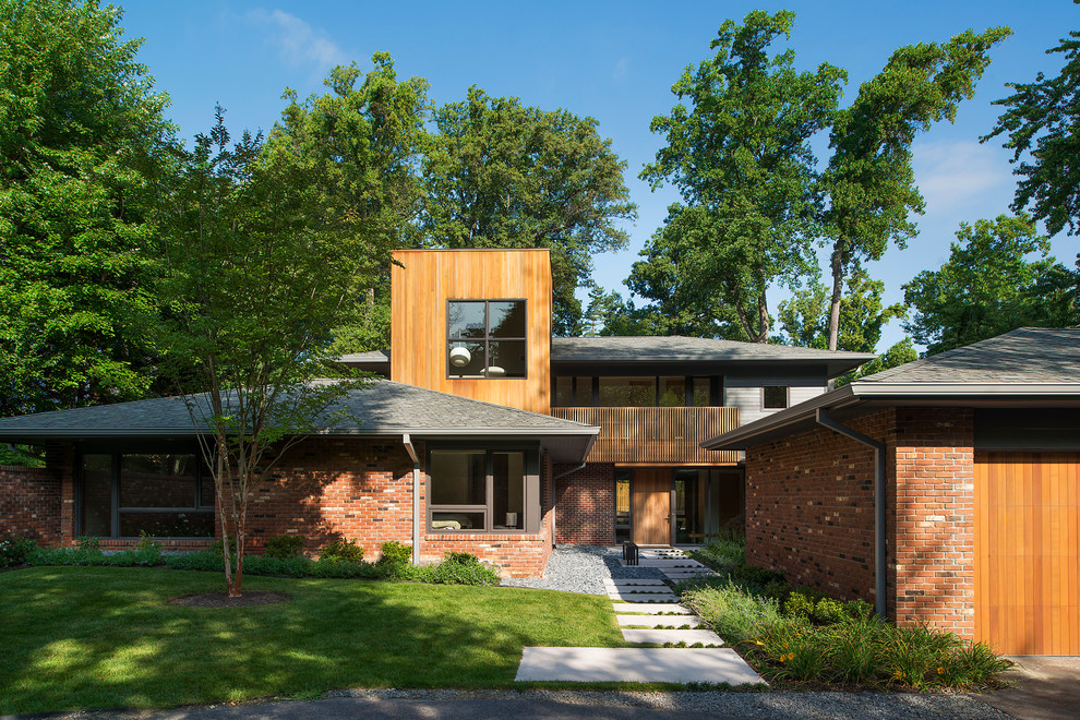 Mid-sized contemporary red two-story mixed siding exterior home idea in DC Metro with a hip roof