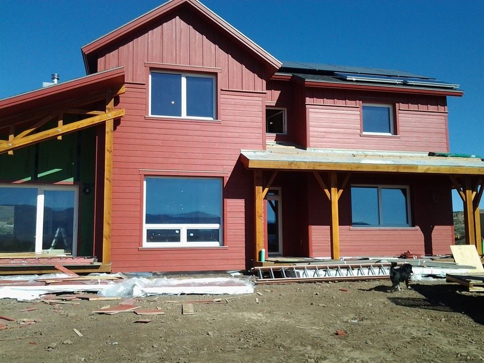 Inspiration for a mid-sized cottage red two-story concrete fiberboard exterior home remodel in Salt Lake City