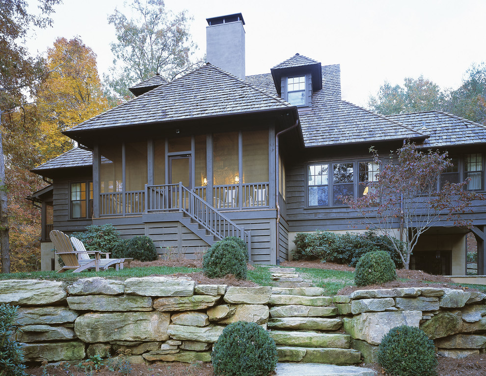 Inspiration for a timeless wood exterior home remodel in Atlanta with a hip roof